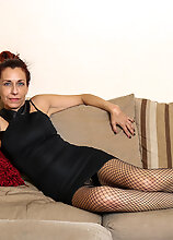Naughty Masturbating Mature Lady Chilling On The Couch