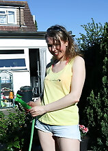 Hairy Mature Lady Playing With The Hose In The Garden