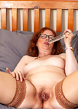 Naughty Mature Lady Playing With Her Pussy In Bed